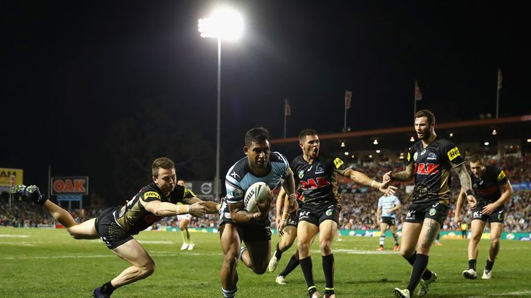Ben Barba scores a try against Penrith Panthers as Zak Hardaker (r) looks on