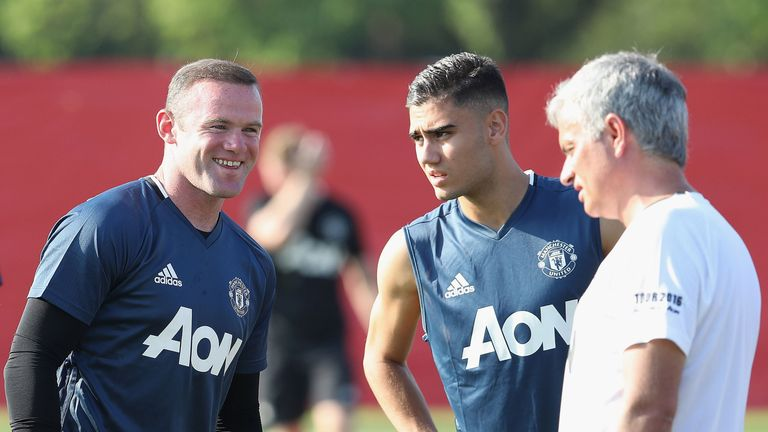 Wayne Rooney enjoys a joke with Jose Mourinho during a training session in Shanghai