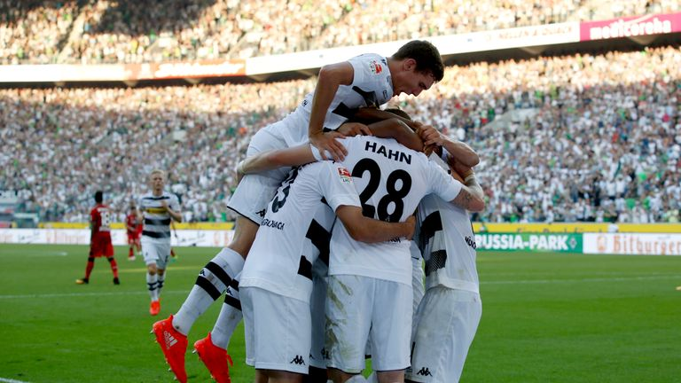 Andre Hahn celebrates opening the scoring for Borussia Moenchengladbach