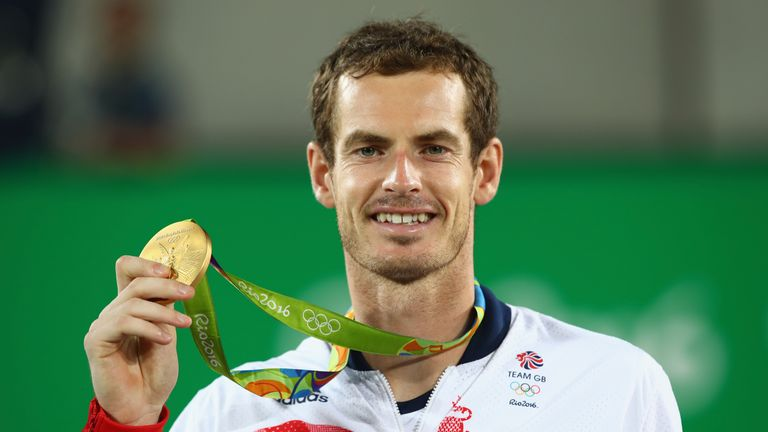 Andy Murray poses with the gold medal on the podium at the Rio Olympics