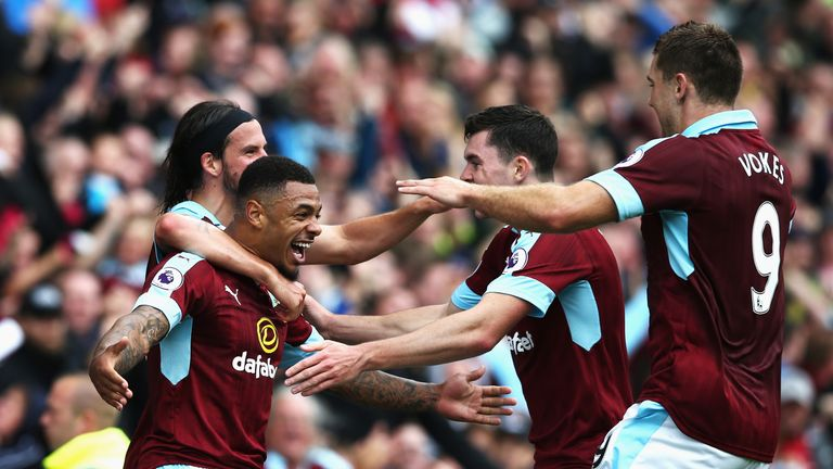 Andre Gray celebrates scoring Burnley's second goal against Liverpool