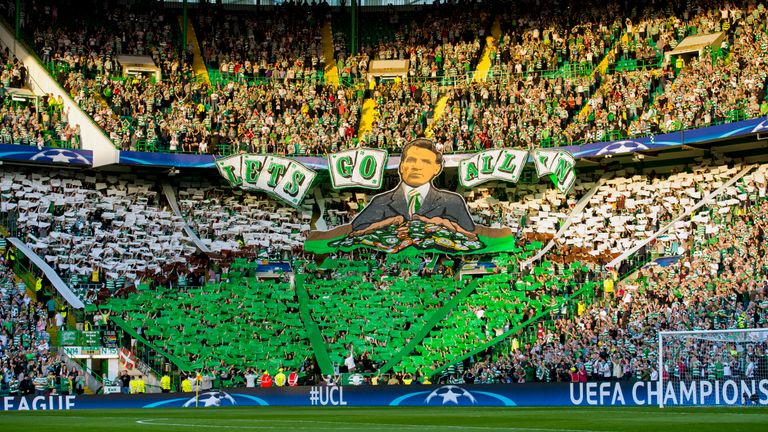 Celtic fans show a display reading 'Let's go all in' before the start of the game