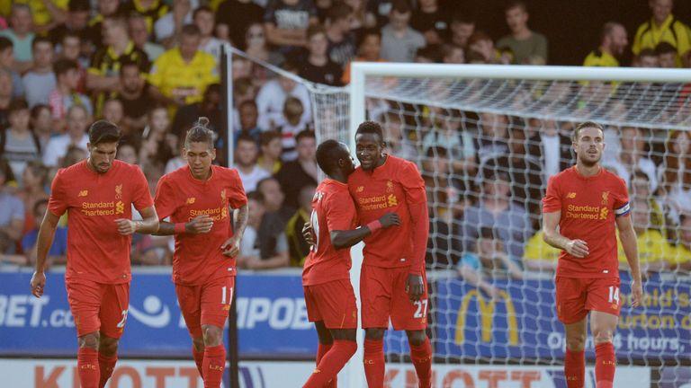 Liverpool's Belgian striker Divock Origi  is congratulated after scoring