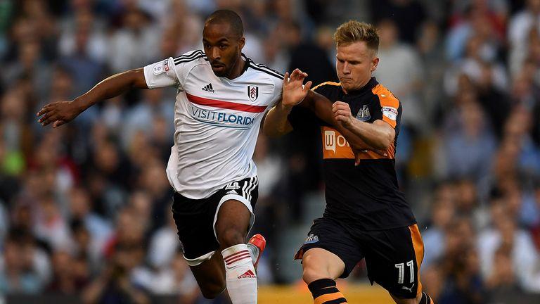 Dennis Odoi of Fulham holds off pressure from Matt Ritchie