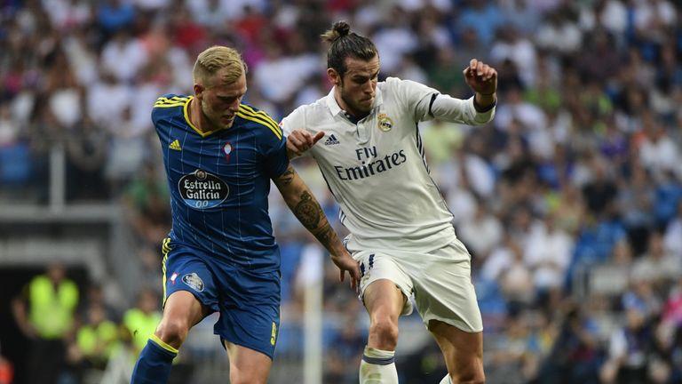 Gareth Bale (right) battles it out with Celta Vigo's Iago Aspas
