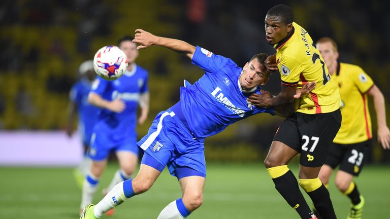 Gillingham's Cody McDonald and Watford's Christian Kabasele tussle for the ball in a game that saw the League One side win in extra-time