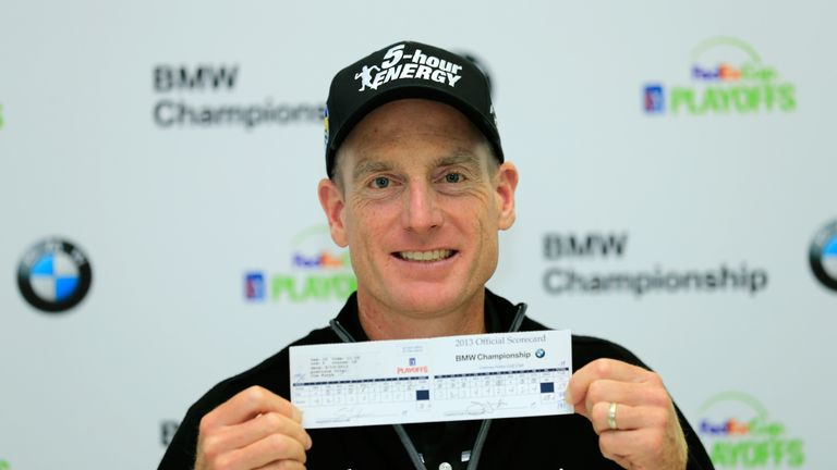 Jim Furyk holds up his scorecard after his 12-under 59 at the BMW Championship in 2013