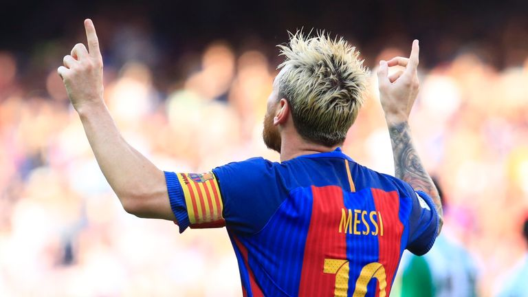 Lionel Messi celebrates after his goal against Real Betis