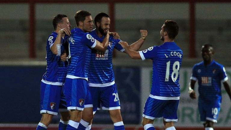 Bournemouth's Marc Wilson (third right) celebrates with team-mate Lewis Cook (right)