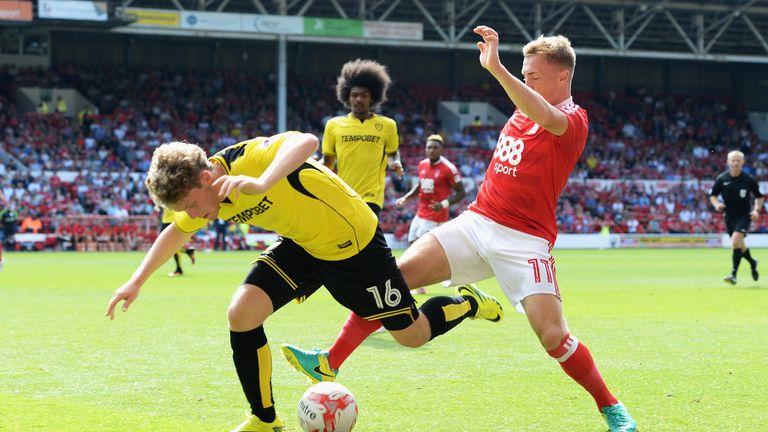 Matt Palmer (left) is tackled by Ben Osbourne