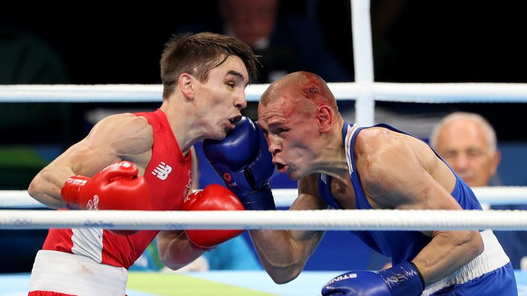 Vladimir Nikitin (right) beat Michael Conlan but withdrew due to cuts