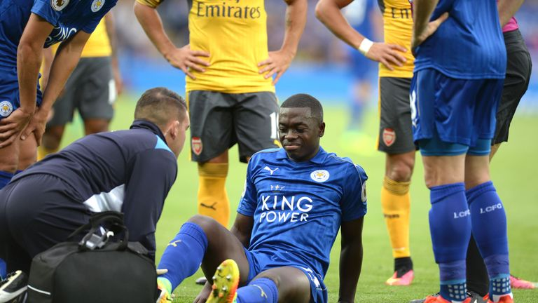 Nampalys Mendy (C) receives attention on the pitch against Arsenal