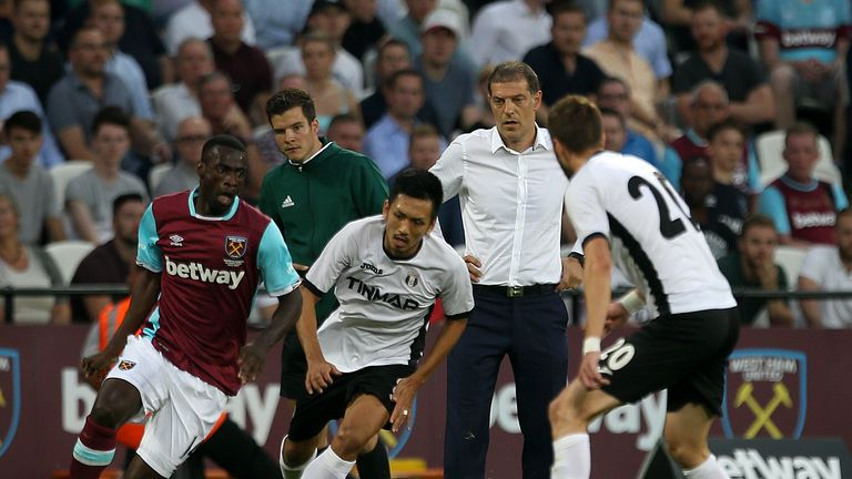 Pedro Obiang (left) and Takayuki Seto (second left) battle for the ball