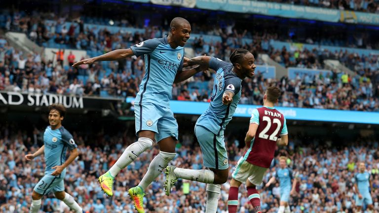Sterling celebrates with team-mate Fernandinho at the Etihad Stadium