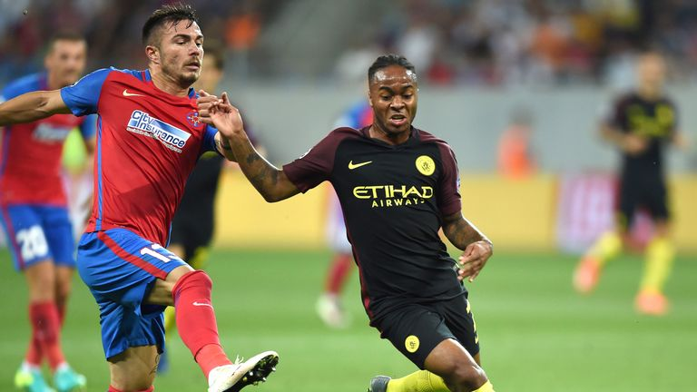 Raheem Sterling (R) vies for the ball with Alin Tosca