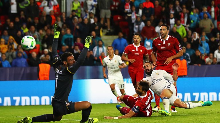 Sergio Rico (left) could not prevent Dani Carvajal's late winner for Real Madrid in the Super Cup final