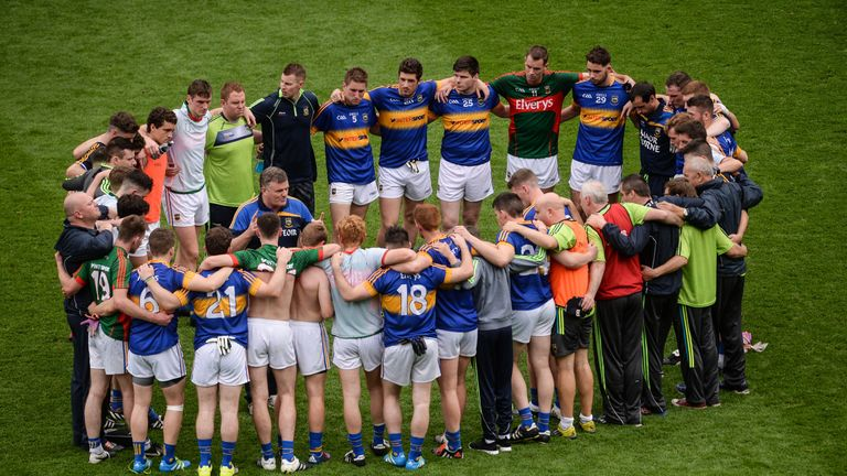 Tipperary manager Liam Kearns in a huddle with his players after the game