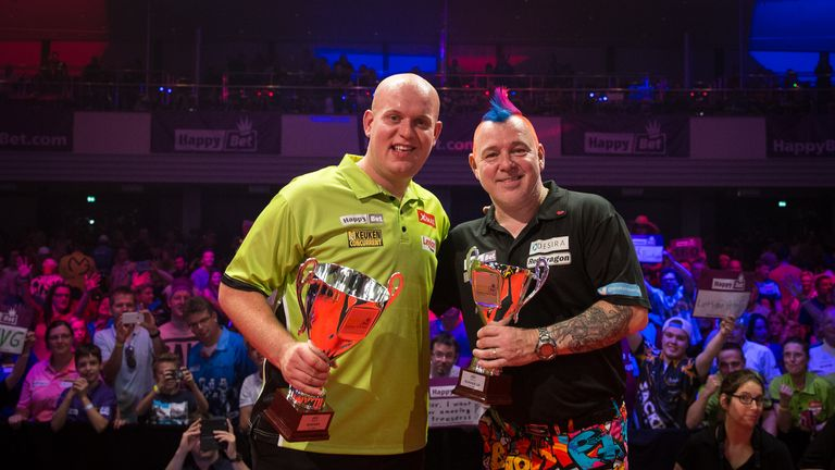 The 27-year-old won the title for the second year running, defeating Peter Wright in Dusseldorf