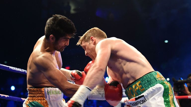 Singh (left) aims an uppercut at Kerry Hope