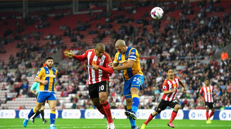 Wahbi Khazri of Sunderland jumps with Adam El-Abd of Shrewsbury Town