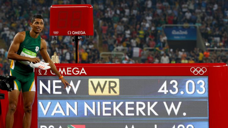 Wayde van Niekerk celebrates winning gold and setting a new world record in 400m Olympics final