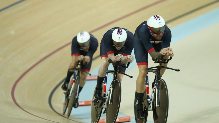 Clancy (centre) follows Wiggins on the way to winning gold in Rio