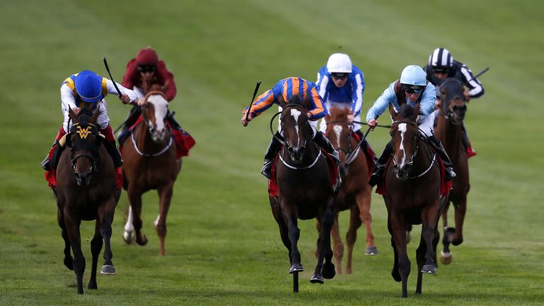 Seamie Heffernan and Brave Anna get the better of a battle with Roly Poly to win the Cheveley Park Stakes, with Lady Aurelia (far left) fading into third.