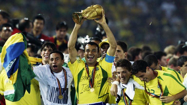 Brazil legend Cafu lifts the World Cup aloft in 2002