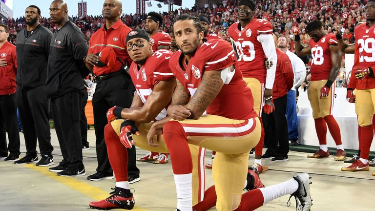 Colin Kaepernick (right) kneels during the national anthem prior to a fixture last season