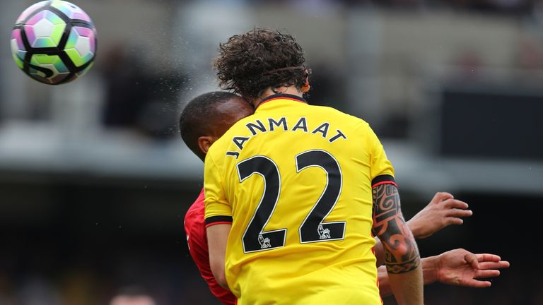 Watford's Daryl Janmaat received treatment off the pitch before returning later on