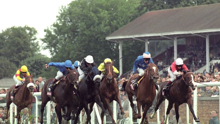 Frankie Dettori riding Diffident to victory in the Racal Diadem Stakes at Ascot