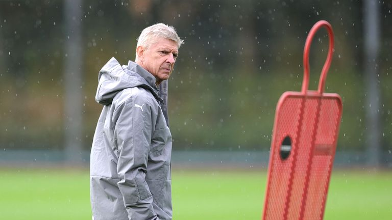 Wenger looks on during a training session at London Colney