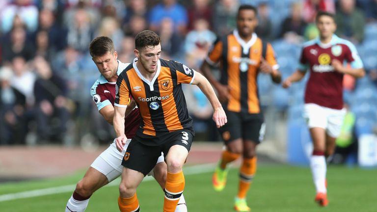 Johann Berg Gudmundsson of Burnley puts pressure on Andy Robertson