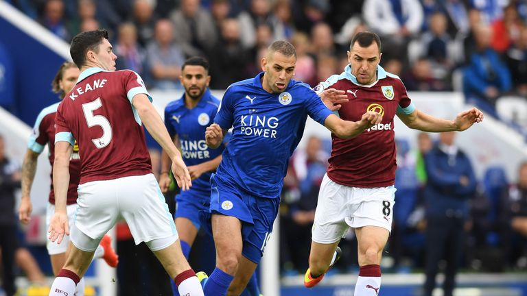 Islam Slimani of Leicester (C) takes the ball past Michael Keane of Burnley during the Premier League clash