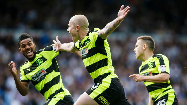 Aaron Mooy celebrates after scoring Huddersfield's winner against Leeds