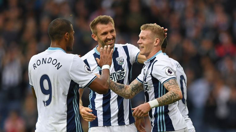 James McClean of West Bromwich Albion (R) celebrates scoring his side's third goal