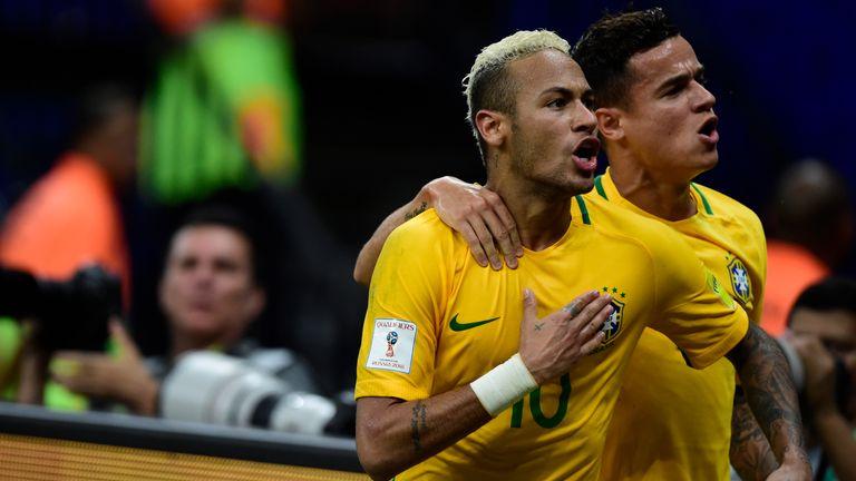 Neymar (left) celebrates after scoring the winning goal for Brazil against Colombia