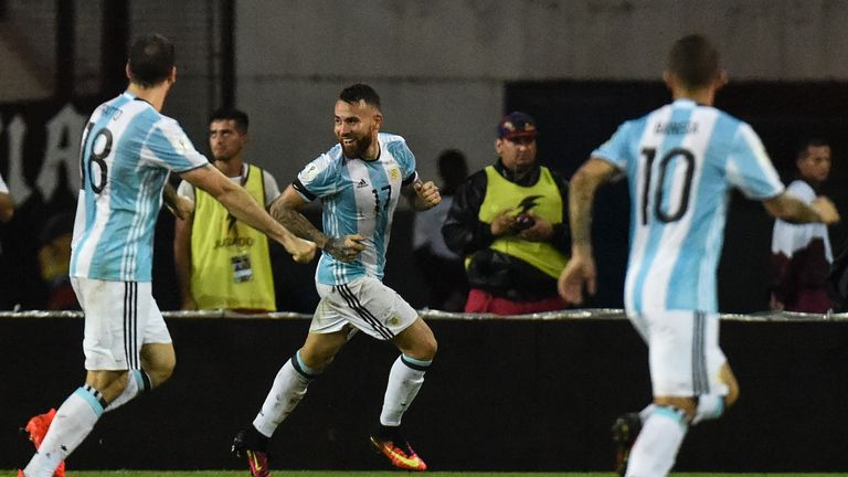 Argentina's Nicolas Otamendi (C) celebrates after scoring against Venezuela