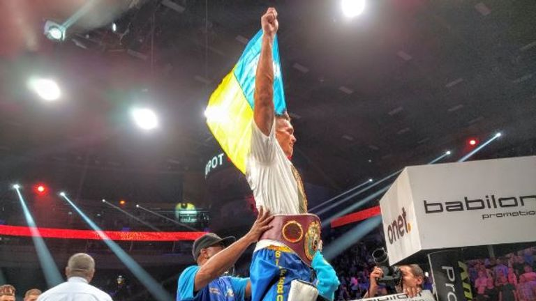 Oleksandr Usyk celebrates becoming world champion (credit gamekmedia/Twitter)
