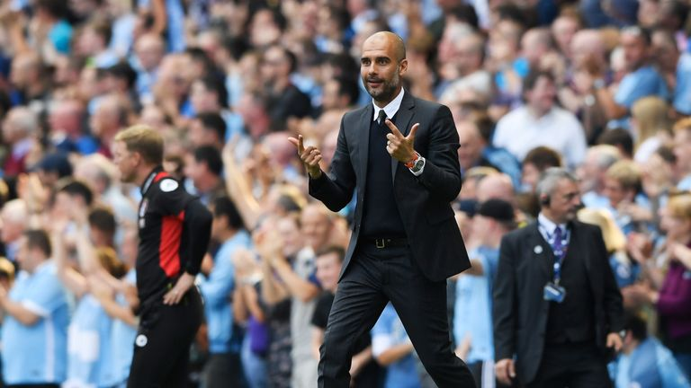 Manchester City boss Pep Guardiola shows his delight after his side's second goal against Bournemouth