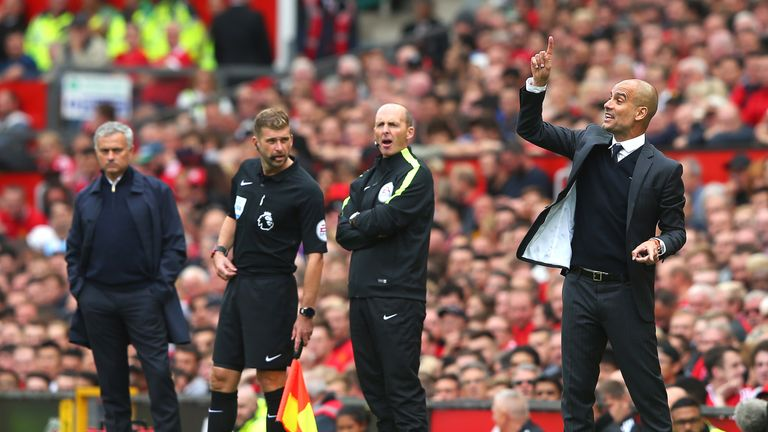 Pep Guardiola (right) reacts on the touchline at Old trafford