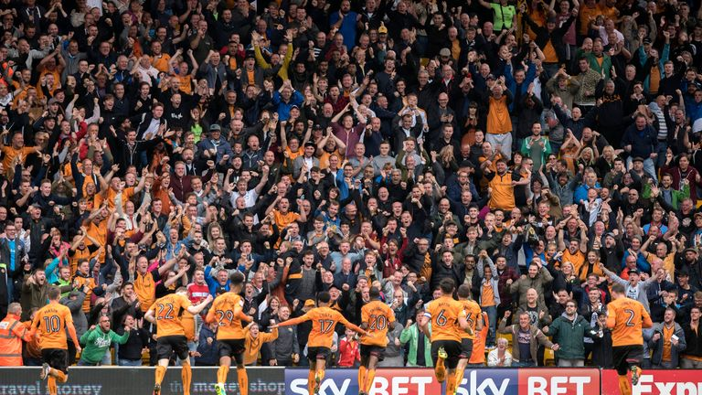 Wolves players and fans celebrate after Prince Oniangue (20) scored the opening goal