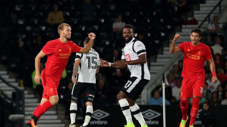 Ragnar Klavan (L) of Liverpool celebrates scoring the opening goal