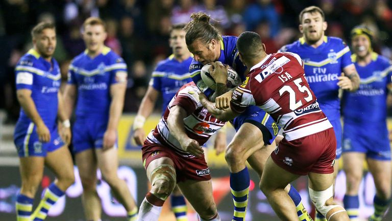 Ashton Sims is tackled by Tony Clubb (left) and Willie Isa during Warrington's 28-16 win at Wigan on April 1