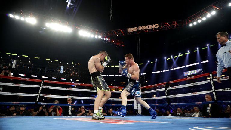 Canelo (R) has beaten Callum Smith's brother Liam