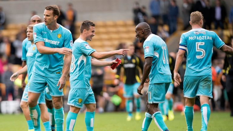 Burton's Will Miller and Lloyd Dyer celebrate after grabbing a point against Wolves in their Sky Bet Championship match