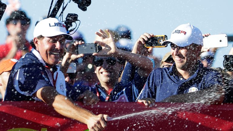Phil Mickelson and Jordan Spieth celebrate their Ryder Cup triumph last year