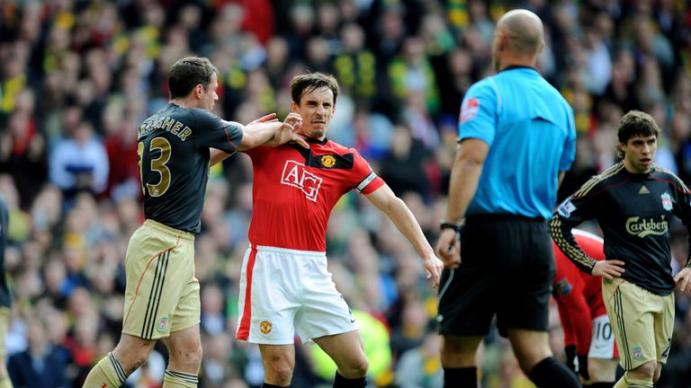 Jamie Carragher (L) of Liverpool argues with Gary Neville of Manchester United after United were awarded a penalty in the  first half, March 2010