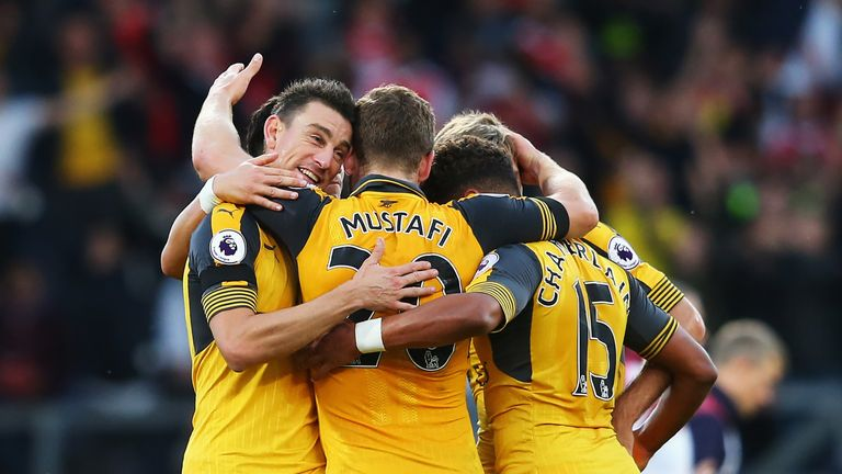 Laurent Koscielny celebrates Arsenal's match winning goal with his team-mates