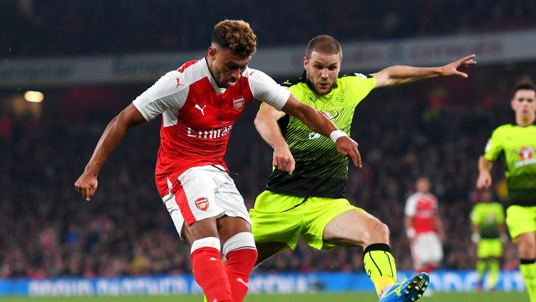 Alex Oxlade-Chamberlain of Arsenal (L) scores his side's first goal against Reading
